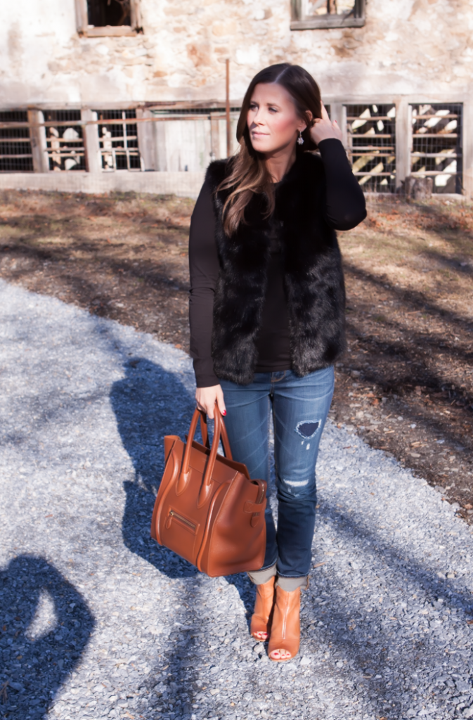 Black Fur Gilet, Black Long Sleeve Tee, Distresed Skinny Jeans, Peepe Toe Booties, Cognac Sturctured Tote, Pearl Earrings, Top Shop, J.Crew, Paul Green, Celine