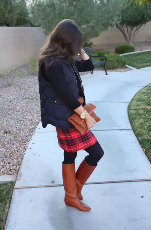 Red and Navy Plaid Skirt, Navy Sweater,  Navy Quilted Vest, Cognac Boots, Belt and Foldover Clutch 8