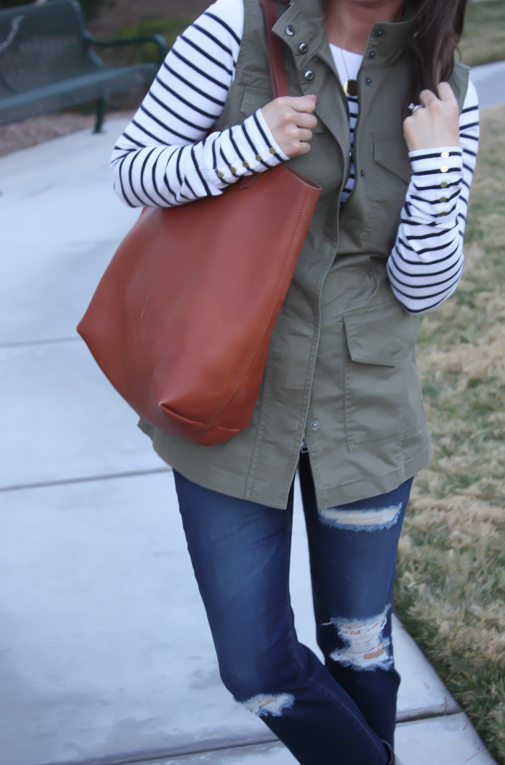 Army Green Utility Vest, Navy Striped Tee, Distressed Skinny Jeans, Tan Mules, Cognac Tote, Banana Republic, H&M, AG Jeans, Dolce Vita, Madewell  7