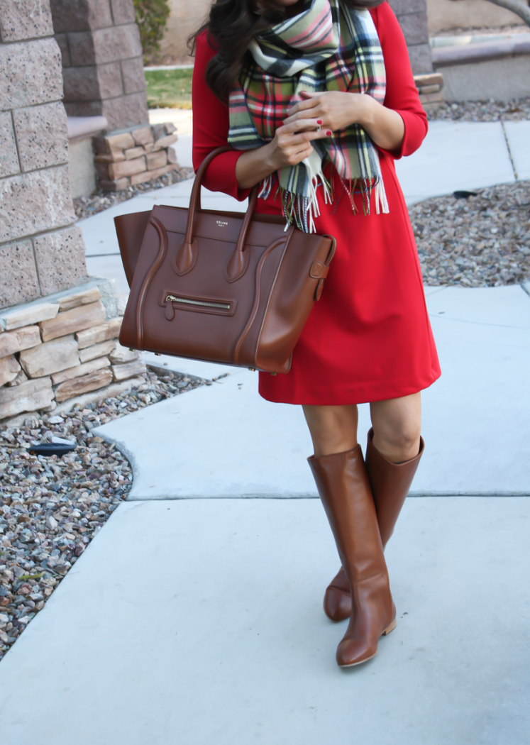 red dress, plaid scarf, brown bag, brown boots