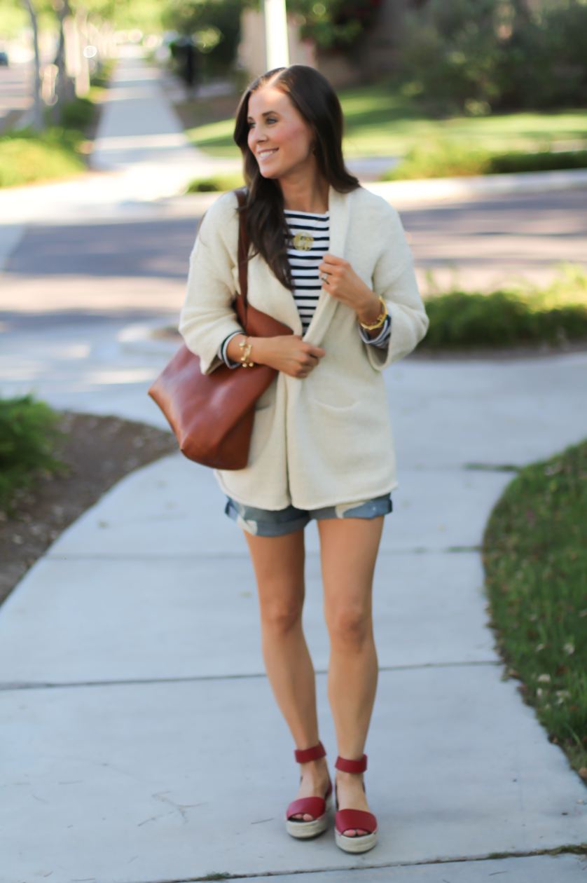 Beige Summer Sweater, Striped Tee, Distressed Denim Shorts, Red Espadrille Sandals, Tan Leather Tote 5