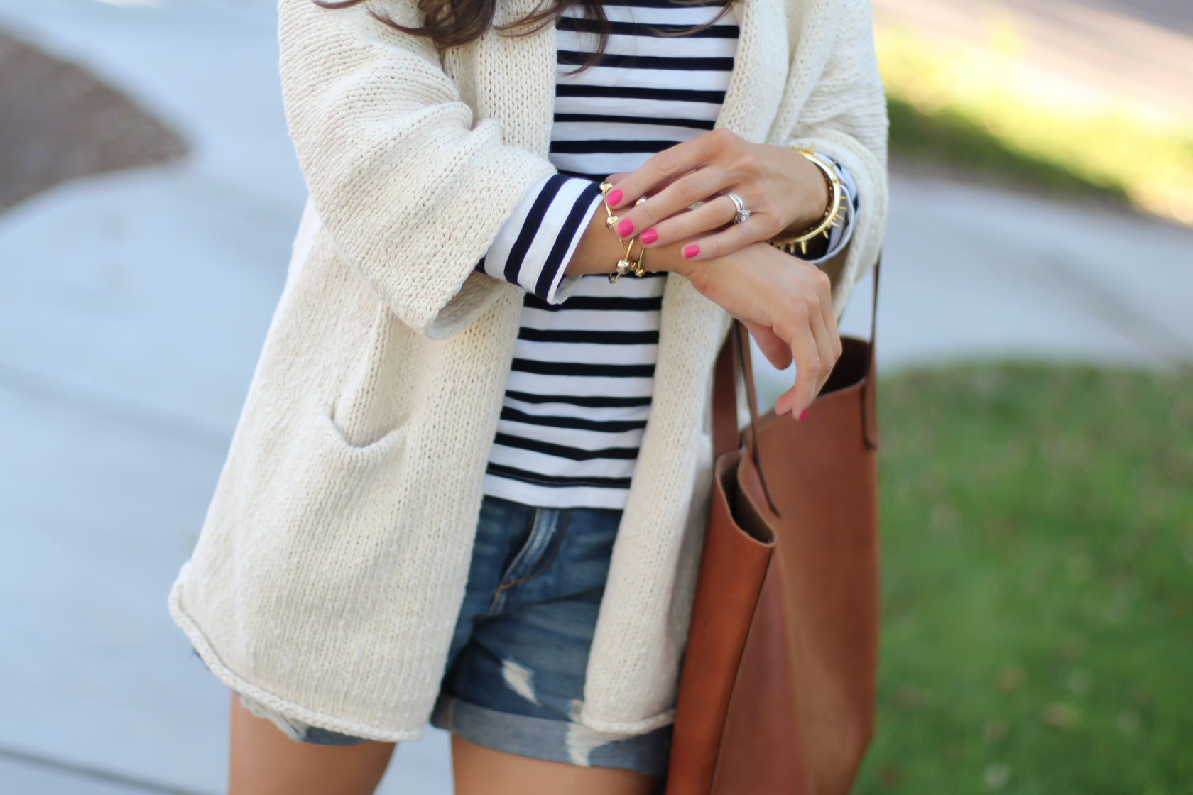 Beige Summer Sweater, Striped Tee, Distressed Denim Shorts, Red Espadrille Sandals, Tan Leather Tote